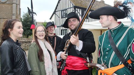 Cassie Rouse and Maddie Palmer with roundhead soldiers, on St Mary's Green.