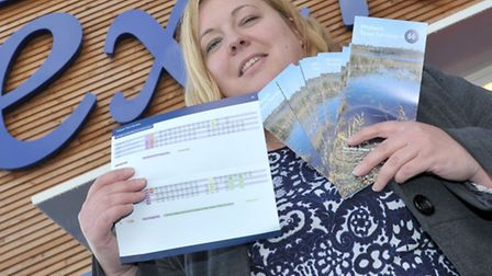 Cllr Sam Hoy with bus timetables outside Tesco Extra at Wisbech. Picture: Steve Williams.