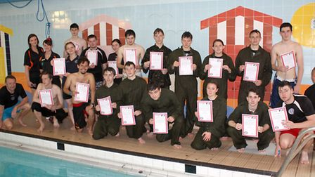 Uniformed services with their certificates with tutors John Yare & Adrian Kent. Far Left is Hudson l