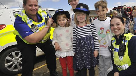 Ely St Johns C of E Primary School Spring Fair, (l-r) PCSO Kat Deronal, Bea, Ruby, Freya, Reece, and