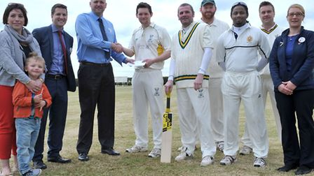 Chatteris cricket team first game of season. Left: Clare Foster Tesco group personel officer, Scott