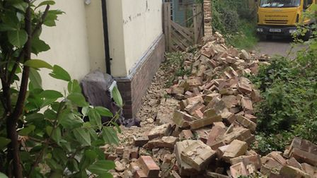 The 40 foot long wall came crashing down after being hit by a reversing dustcart