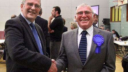 Cllrs Alex Miscandlon and Ralph Butcher celebrate retaining their Benwick, Coates and Eastrea seats.