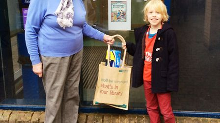Gil Edmenson-Lovesey, who is pictured being presented with the winning goodie bag by Daphne Cyrinski