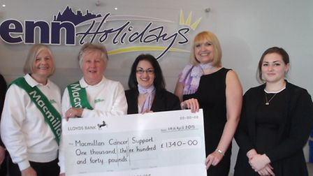 The staff of Fenn Holidays presenting the cheque to Gillian Kime and Sue Oldroyd of the Macmillan Fu