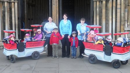 Staff from the Maltings Day Nursery with youngsters.