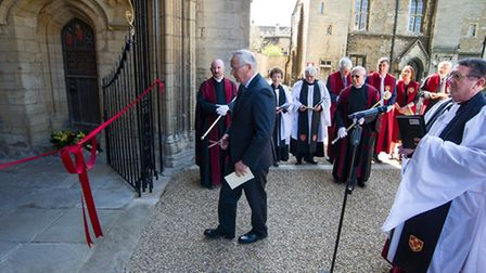 His Royal Highness The Duke of Gloucester cutting the ribbon across the entrance during the service.
