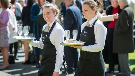 Students from Peterborough Regional College serving refreshments in the cloisters. Pictures: Matthew