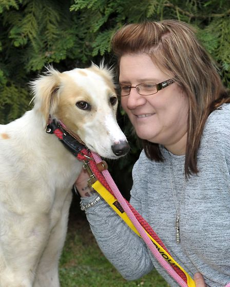 Shelley Ridgeon from Ravenswood pet rescue with Drifter. Picture: Steve Williams.