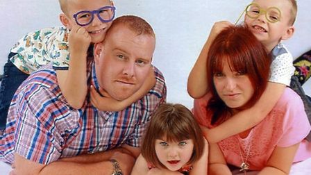 Becky and James Dinolt with their children Tyrone, Daniel and Evie, in a family portrait taken at Pi