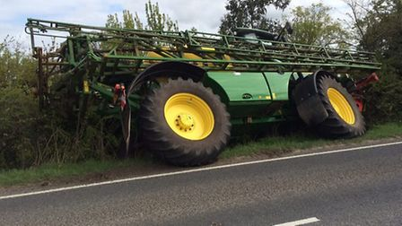 The tractor ended up in a ditch. Picture: Cambs Fire and Rescue Facebook