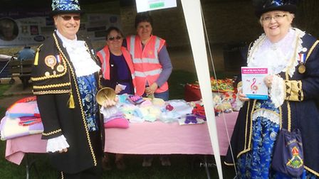 Pictured with two of the fund-raising team, Chris Barker and Ruth Donnally, are Ely town crier Avril