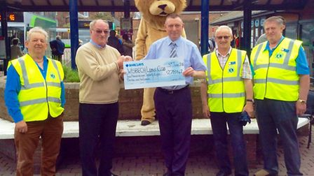 Centre manager, Kevin Smith presents President Lion Ray Hill from the Wisbech Lions Club with the ch