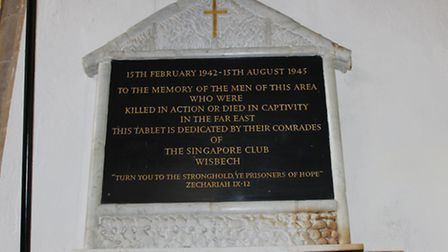 The white marble and black slate plaque in St Peter's Church was donated by the Singapore Club, Wisb
