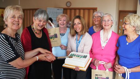 Jenny Johns, far left, with library at home volunteers.