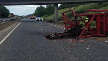 A47 could be closed well into the evening after a lorry carrying heavy offshore equipment hit a brid
