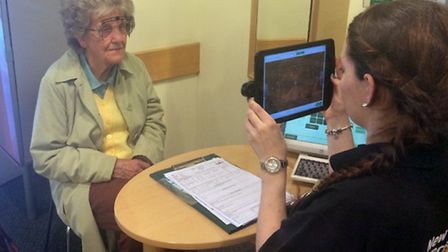 A customer finds out more about the Digital Precision Eyecare.