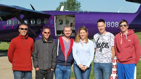 Stormport staff prepare to carry out their charity skydive.