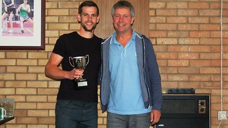 Ben Mitchell, winner of Ely Squash & Leisure's annual tournament, receiving his trophy from club dir