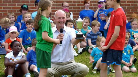 Mr Talbot presents the cup to Katie Hughes and Oliver Smith