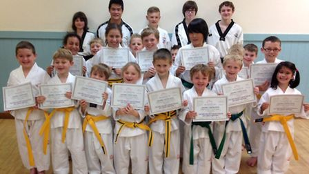 Students with their grading certificates.