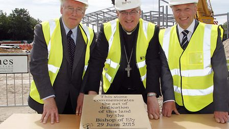 Stephen Conway, the Bishop Of Ely (centre) at the site dedication in Cambridge with Barnes Construct
