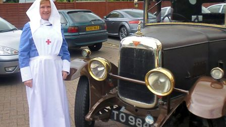 Rosemary Westwell next to the 1927 Alvis.