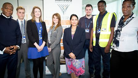 Employment Minister Priti Patel, centre, visited the Airports Employment and Training Academy to tal