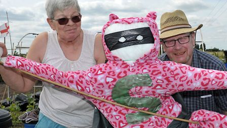 Allotment open day, Chatteris. Carole and Graham Clarke with their scarcrow,Picture: Steve Williams.