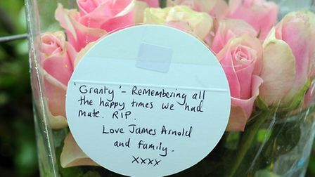 Messages on flowers left at the scene of a car crash in Worlington.