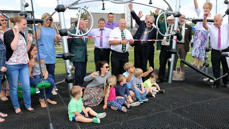 Cllr Peter Murphy cuts the ribbon at the official opening.