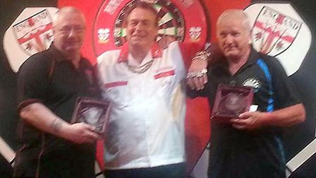 Dennis Harbour, left, and Steve Carrett, right, with BDO darts legend Bobby George.