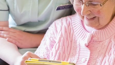 Heron House resident gets to grips with new technology