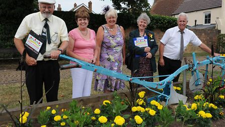 Anglia in Bloom judges with members of Chatteris in Bloom being shown one of the displays