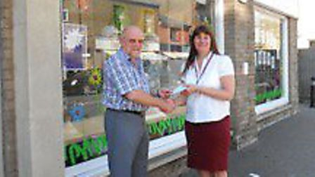 Ian Fawcett, Whittlesey Masonic Benevolent Association's worshipful master, presents a cheque to EAC
