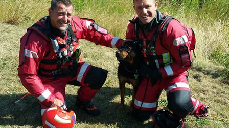 A dog was rescued from a pond.