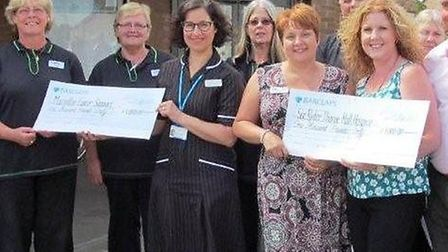 Macmillan Cancer Care Support and the Sue Ryder Thorpe Hall Hospice have each received a cheque for
