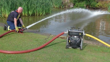 Firecrew save fish in a pond at Friday Bridge