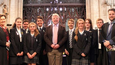 Simon Weston, centre, with staff including principal Sue Freestone, left, and students at the prize