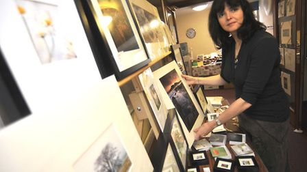 Jane Goodall, from Bottisham with her photographs at the cathedral centre's craft fair in November l