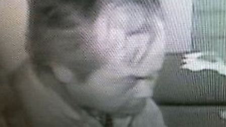 CCTV image of man police wish to speak to in connection with Soham takeaway burglary.
