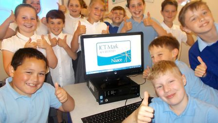Pupils celebrate as Park Lane Primary School receives the ICT Mark.