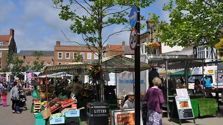 Wisbech Sunday market - experts condemned town council plans to fell the trees