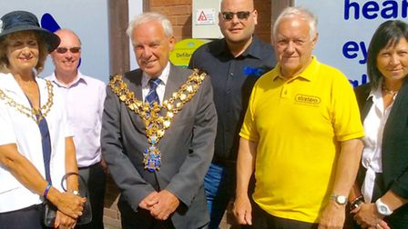 Local representatives have come together to bring a 24/7 defibrillator to Wisbech. Left: Centre mana