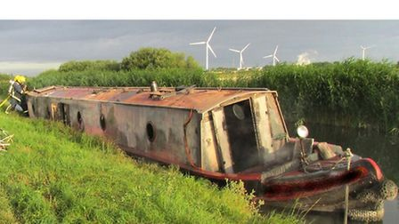 Fire crews were called to extinguish a narrowboat fire on Kings Dyke, Whittlesey. Picture: CAMBS FIR