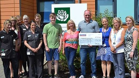Mark Cross presents a cheque to Peterborough City Hospital.
