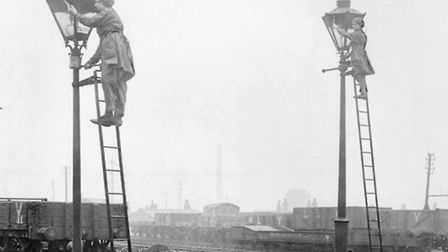 Women railway workers obscuring gas lamps at the Lancashire & Yorkshire Railway's Horwich works, Gre