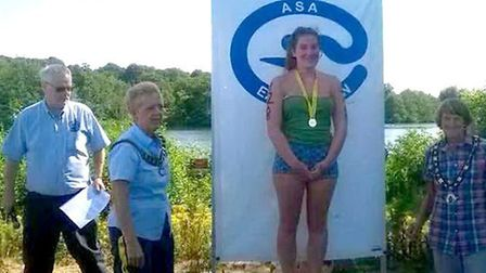 Barracudas snap up gold at region open water champs. Julia.