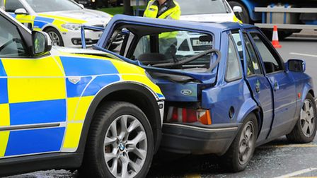 Police on the scene of the collision on the Newmarket Road/Daniels Road roundabaout, Norwich. Photo