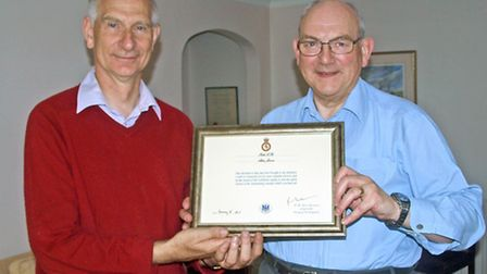 The Rev Alan Jesson, right, receives his commendation from Lt Col Stephen Martin.